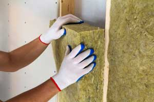 Wall insulation reduces heating and cooling costs